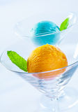 Yellow and blue ice cream balls Royalty Free Stock Photography