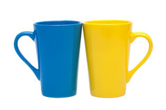 Yellow and blue mug. On a white background Royalty Free Stock Photos