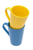 Yellow and blue mug. On a white background Royalty Free Stock Image