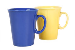 Yellow and blue mugs isolated Stock Image