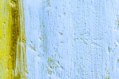 Textured Background of Paint and Old Canvas. Yellow and Blue oil paint frames a perfect slide presentation for your next project Royalty Free Stock Photo