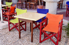 Yellow ,blue and orange wooden armchairs outdoor Royalty Free Stock Photo