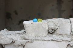 Yellow and blue paint balls Stock Photography