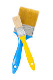 Yellow and blue paintbrushes isolated Royalty Free Stock Photos