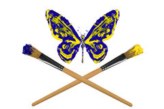 Yellow and blue painted butterfly hover above crossed paintbrush Royalty Free Stock Photos