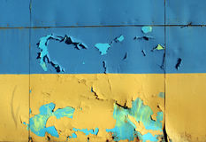 Yellow and blue painted metal wall texture with cracked surface. Stock Photo