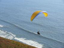 Yellow blue paraglider Stock Images