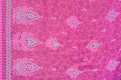 Yellow, Blue and Pink Flowers Fabric Texture. A Pinkish Fabric Texture of a Sarong with hearts Royalty Free Stock Photos