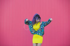 Yellow, blue and pink photo of a teen woman with afro hair liste Royalty Free Stock Photo