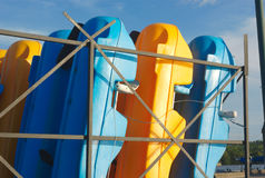 Yellow and blue plastic pedalboat pedalo location in a row summer vacation Royalty Free Stock Photos