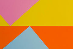 Yellow, blue, purple and orange color paper background. Top view Stock Photography