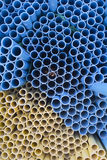 Yellow and blue pvc pipes Royalty Free Stock Photos