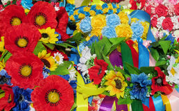 Yellow blue and red artificial flowers Stock Photos