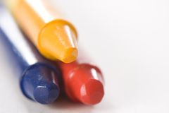 Yellow Blue Red Crayon. Yellow crayon stacked on top of blue and red crayon Stock Images