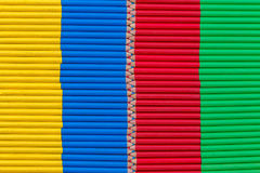 Yellow, blue, red and green background composed of small pencils. Yellow, blue, red and green background composed of small colored pencils Royalty Free Stock Photo