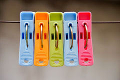 Yellow, blue, red and green clothes. Clothes pin set Stock Image