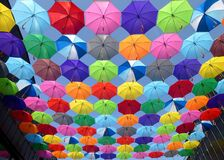 Yellow Blue Red Pink Purple Green Multicolored Open Umbrellas Hanging on Strings Under Blue Sky Royalty Free Stock Photo