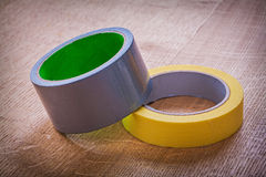 Yellow and blue rolls of duct tape on vintage Stock Photo