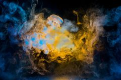 Yellow and blue smoke patterns royalty free stock images