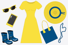 Yellow and blue spring/summer set for woman, flat, vecto. Beauty spring/summer set for woman, flat, vector: a wide-brimmed hat, a yellow dress, a mobile phone vector illustration
