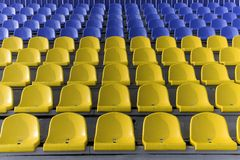 Yellow and blue stadium seats Stock Photos