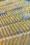 Yellow and blue stadium seats and stadium stairs Royalty Free Stock Images