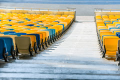 Yellow and blue stadium seats and stadium stairs Stock Photography