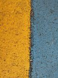 Yellow and blue stripes on the highway Stock Images