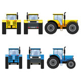 Yellow and blue tractors with big wheels. Royalty Free Stock Photo