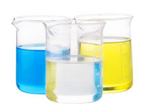 Yellow, blue and transparent chemical liquid Royalty Free Stock Photos