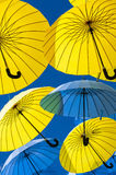 Yellow and blue umbrellas. Stock Photo