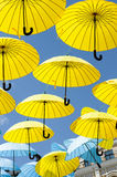 Yellow and blue umbrellas. Stock Photography