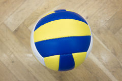 Yellow Blue volleyball in the gym Royalty Free Stock Photos