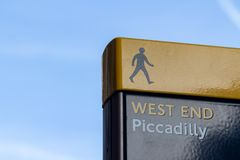 Yellow and blue West End Piccadilly sign on clear sky. Place for text stock photography