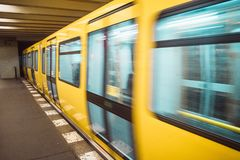 Yellow blurred subway train in Berlin royalty free stock photography