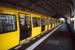 Yellow blurred subway train in Berlin stock image