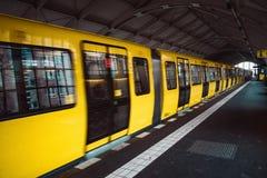 Yellow blurred subway train in Berlin stock photography