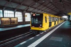 Yellow blurred subway train in Berlin royalty free stock image