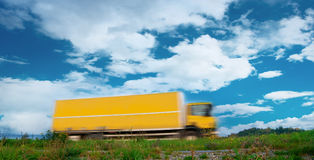Yellow blurred truck Royalty Free Stock Photography