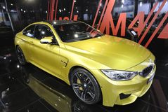 Yellow bmw m4 sport car. ,17th Chengdu Motor Show, August 29th-September 7th, 2014. Chengdu Motor Show, One of the big four auto show in China Stock Photo