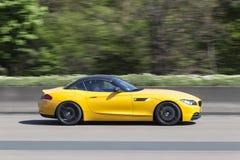 Yellow BMW sports car. Frankfurt, Germany - March 30, 2017: Yellow BMW sports car on the highway in Germany Stock Photo