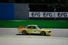 Yellow BMW Touring Car at the Ascari Chicane Stock Photos