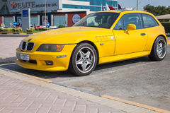 Yellow BMW Z3 M Coupe car stands parked in Manama Royalty Free Stock Photo