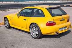 Yellow BMW Z3 M Coupe car stands parked on the roadside Royalty Free Stock Photography