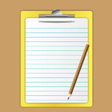 Yellow board. And paper sheet and pencil Royalty Free Stock Photos