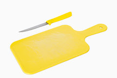 Yellow board and knife Royalty Free Stock Photo
