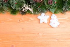 Yellow board with needles and cones Christmas toys and Christmas Royalty Free Stock Photos