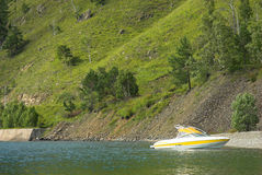 Yellow boat. Staying near shore Royalty Free Stock Images
