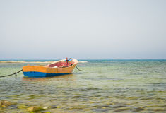 Yellow boat on a beach Stock Image