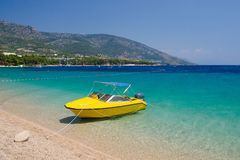 Yellow boat near cape Zlatni Rat of Brac Island, Adriatic Sea, C royalty free stock photo